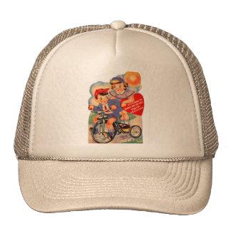 Chica y muchacho retros de la tarjeta del día de gorras