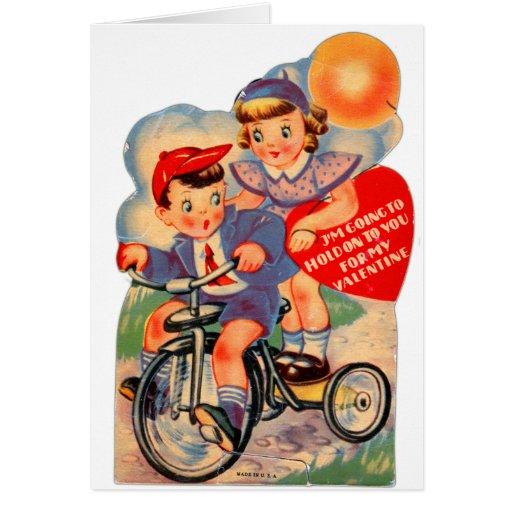 Chica y muchacho retros de la tarjeta del día de S