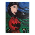 Chica y sus gatos negros postales