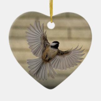 Chicadee in flight ceramic ornament