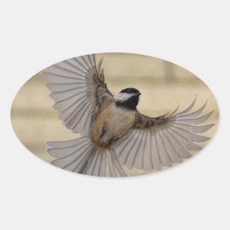 Chicadee in flight oval stickers