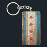 "Chicago Flag on Old Wood Grain Keychain<br><div class=""desc"">Chicago Flag on Old Wood Grain Feel free to modify the design according to your own preferences. You may change the design location, orientation, background colors and size. Also, you may add your own text, or slogan set its font, location and size, all in order to create the ultimate personal...</div>"