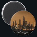 """Chicago Skyline at night at John Hancock Center Magnet<br><div class=""""desc"""">This photograph was taken from a ship on Lake Michigan. The Chicago skyline at the John Hancock Center glows in the November sky. This photograph copyright protected and may not be used without written permission from this shop.</div>"""