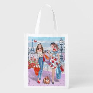 Chicas de compras en bolso de ultramarinos bolsas reutilizables