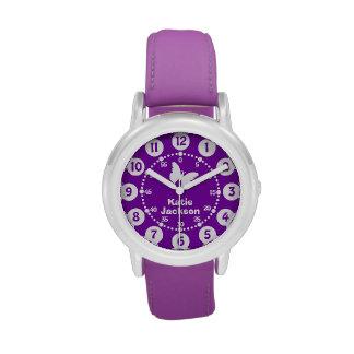 Chicas de los niños púrpuras y reloj blanco del no