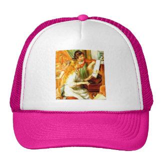 Chicas en el gorra del piano