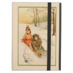 Chicas en un trineo en nieve del invierno