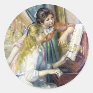 Chicas jóvenes en el piano por Renoir, arte del Etiquetas Redondas