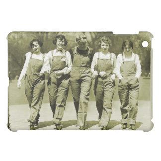 Chicas retros de los guardapolvos de los vaqueros