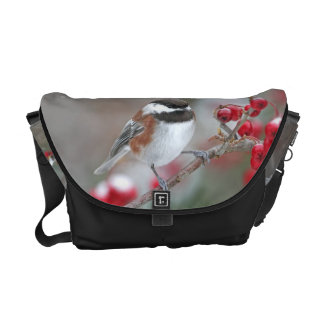 Chickadee in Falling Snow with Red Berries Courier Bag