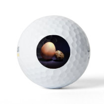 Chicken and quail eggs in love. golf balls