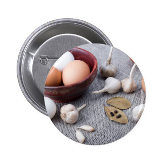 Chicken eggs and garlic and spices on the kitchen pinback button