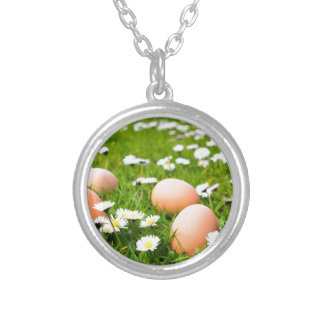 Chicken eggs in grass with daisies silver plated necklace