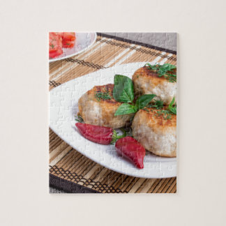 Chicken meatballs of minced meat and a salad jigsaw puzzle
