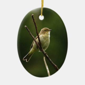 Chiffchaff bird perched on branch ceramic ornament