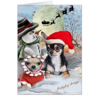 Chihuahua con las tarjetas del muñeco de nieve