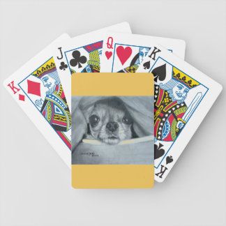 Chihuahua under blanket playing cards