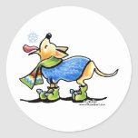 """Chihuahua Winter Snowflake Classic Round Sticker<br><div class=""""desc"""">Original drawing by Off-Leash Art of a cute Chihuahua catching a snowflake on his tongue. He wears a colorful sweater scarf and boots,  making a warm holiday scene. Great decor or gift idea.  Click the orange """"customize it!"""" button to change the background color,  or to add text or photos.</div>"""