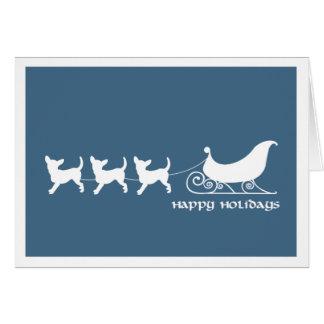 Chihuahuas que tiran del trineo de Santa Felicitacion