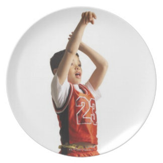 child african american male basketball player in dinner plate