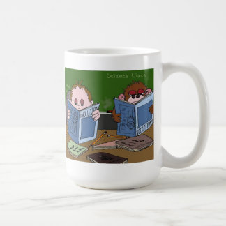 Child and Monkey reading about Evolution Coffee Mugs