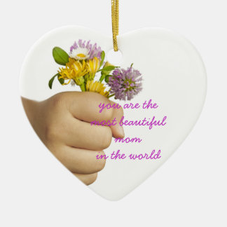 Child Hand Holding Flowers Ceramic Ornament