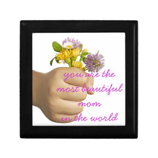 Child Hand Holding Flowers Gift Box