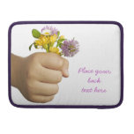 Child Hand Holding Flowers MacBook Pro Sleeves