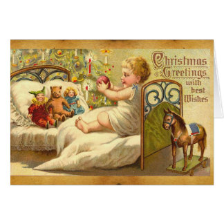CHILD ON THE BED WITH TOYS AND CHRISTMAS GIFTS CARD