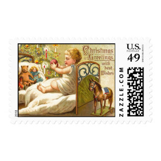 CHILD ON THE BED WITH TOYS AND CHRISTMAS GIFTS POSTAGE