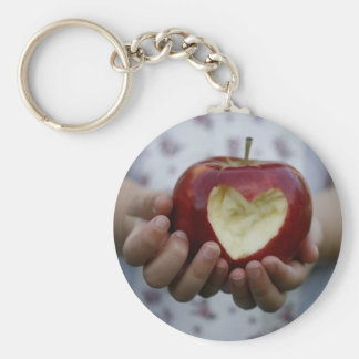 Child with apple heart key chain