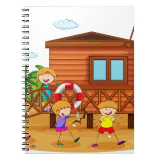 Children and hut spiral notebook