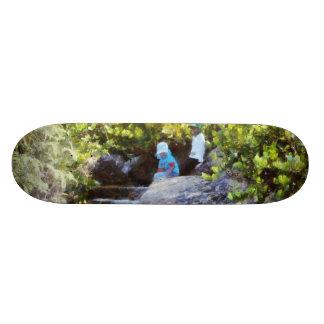 Children at natural pool skateboard deck