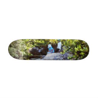 Children at natural pool skateboard