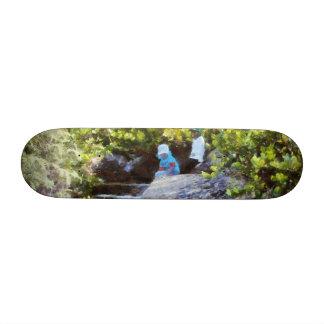 Children at natural pool skate board decks