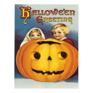 Children Behind A Pumpkin Vintage Postcard