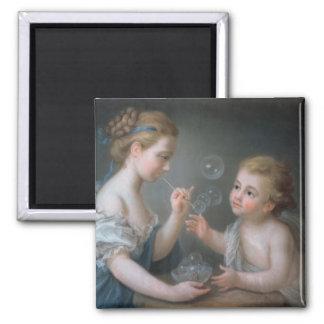 Children blowing bubbles magnet