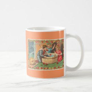 children bobbing apples, apple border coffee mug