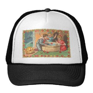 children bobbing apples, apple border trucker hat