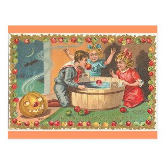 children bobbing apples, apple border postcard