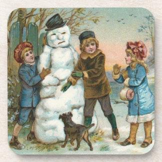 Children building a snowman coaster (set)