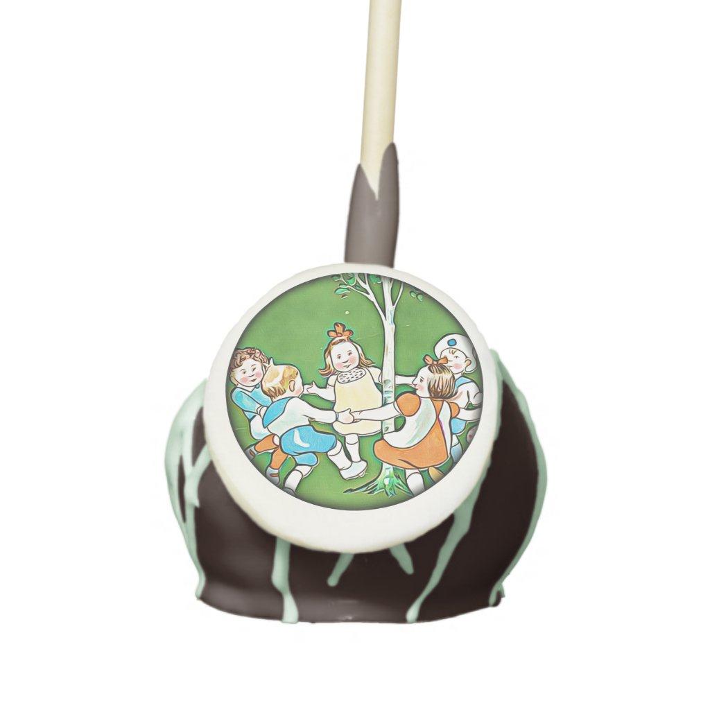 Children dancing, tree, meadow, green cake pops