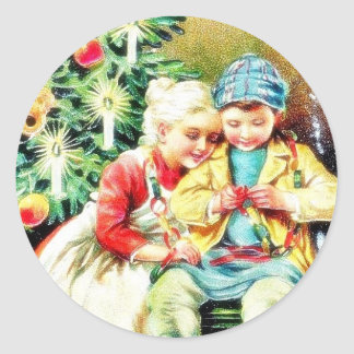 Children getting ready for Christmas night by prep Classic Round Sticker
