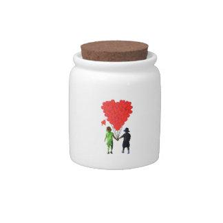 Children holding hands & heart shaped balloons candy jar