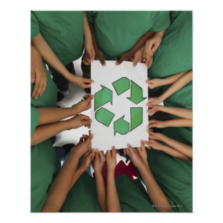 Children holding recycling sign