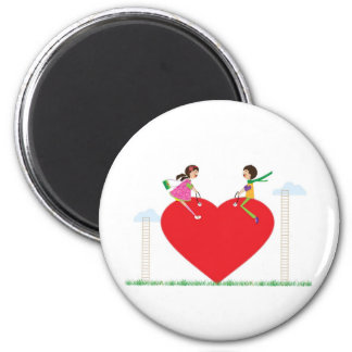 children on a heart shaped see-saw magnet