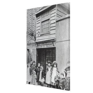 Children outside John Pounds's workshop Canvas Print
