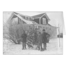 Children outside with Christmas tree cards