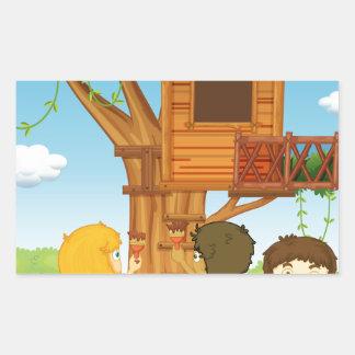 Children painting treehouse in the park rectangular sticker