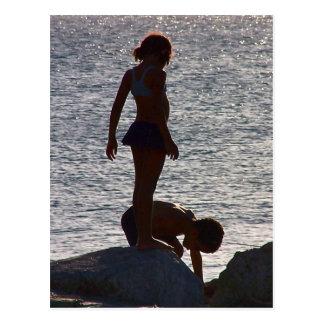 Children play along the rocks, Divi SXM Postcard